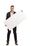 Happy young man holding the blank banner Stock Photography