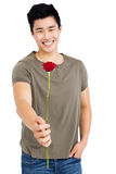 Happy young man holding bunch of red roses Royalty Free Stock Photos