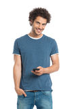 Happy Young Man Holding Cellphone. Portrait Of Handsome Man Holding Cellphone Isolated On White Background Stock Image