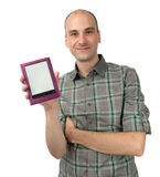 Happy young man holding E-book Stock Photography