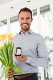 Happy young man holding engagement ring Royalty Free Stock Image
