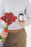 Happy young man holding engagement ring Stock Photos
