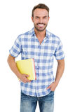 Happy young man holding folder. Portrait of happy young man holding folder on white background royalty free stock photography