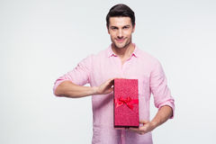 Happy young man holding gift box Stock Photos