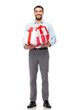 Happy young man holding gift boxes Stock Images