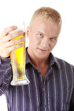 Happy young man holding a glass of beer Stock Image
