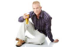 Happy young man holding a glass of beer Royalty Free Stock Images