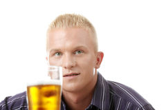 Happy young man holding a glass of beer Royalty Free Stock Photo