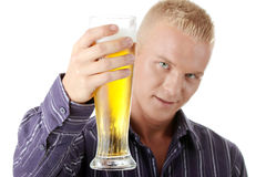 Happy young man holding a glass of beer Stock Photography