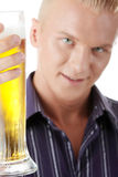 Happy young man holding a glass of beer Stock Images