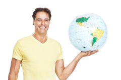 Happy young man holding a globe in hand Stock Photography