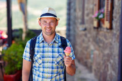 Happy young man holding ice cream Royalty Free Stock Image