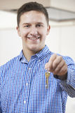 Happy Young Man Holding Keys To New Home Royalty Free Stock Photos