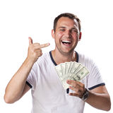 Happy young man holding a pile of cash Royalty Free Stock Photography