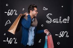 Happy young man holding shopping bags. Stock Photo