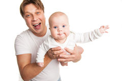 Happy young man holding smiling baby isolated Royalty Free Stock Photos
