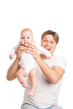 Happy young man holding smiling baby isolated Stock Image