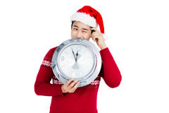Happy young man holding stainless steel clock Royalty Free Stock Photo