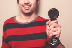 Happy young man holding telephone Royalty Free Stock Photo