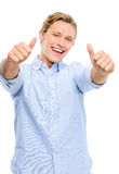 Happy young man holding thumbs up isolated on white background Stock Photo