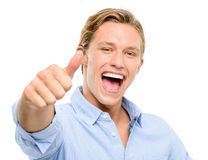 Happy young man holding thumbs up isolated on white background Stock Photos