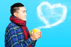 young man  holds a cup with hot coffee or tea stock photos