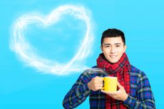young man holds a cup with hot coffee or tea royalty free stock photos