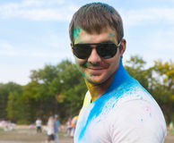 Happy young man on holi color festival Stock Image