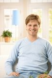 Happy young man at home Stock Photos