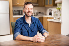 Happy young man at home Stock Image