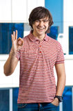 Happy young man indicating OK sign Royalty Free Stock Photo
