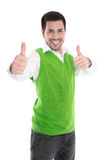 Happy young man isolated in a green shirt and thumbs up. Royalty Free Stock Image