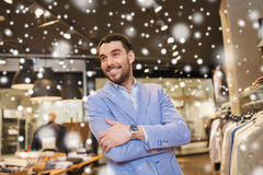 Happy young man in jacket at clothing store Royalty Free Stock Images
