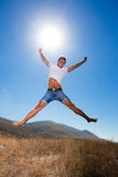 Happy young man jump in the mountains Stock Photos