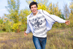 Happy young man jumping Royalty Free Stock Photos