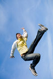 Happy young man - jumping  end flies in blue sky. Royalty Free Stock Photography
