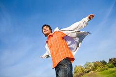 Happy young man - jumping  end flies in blue sky. Royalty Free Stock Photo