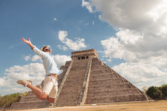 Happy young man jumping of happiness Stock Image