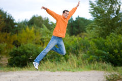 Happy Young Man - jumping in the sky Stock Photo