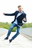 Happy young man jumping Stock Images