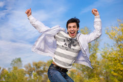 Happy young man jumps into air Royalty Free Stock Photo