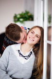 Happy young man kissing his girlfriend in the neck Stock Photo