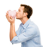 Happy young man kissing piggy bank isolated on white Royalty Free Stock Photography