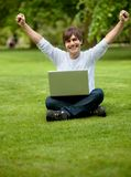 Happy young man with laptop Royalty Free Stock Photo