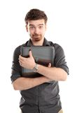 Happy young man with laptop Stock Photography