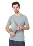 Happy young man with laptop Royalty Free Stock Photography