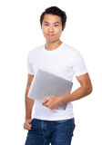 Happy young man with laptop Royalty Free Stock Images
