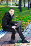 Man with Laptop at the Park Royalty Free Stock Images