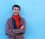 Happy young man laughing with arms crossed Stock Images