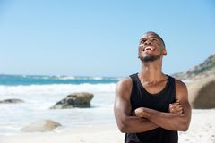 Happy young man laughing at the beach Royalty Free Stock Images